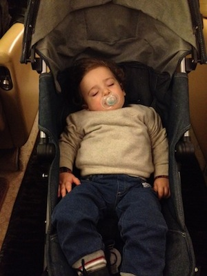 Gabriele sleeping on the flight to Dubai