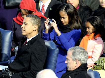 Malia gets her own snaps for the family album (Timothy A. Clary/AFP/Getty Images)