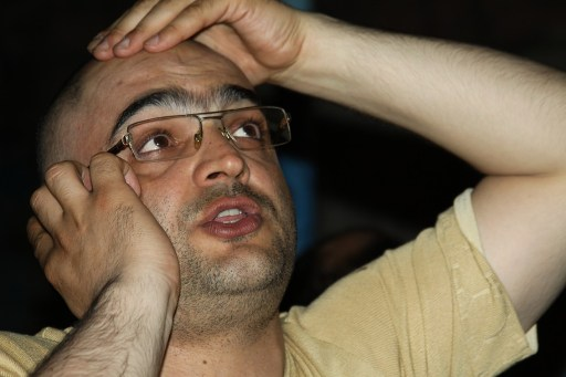 Eynulla Fatullayev speaks with friends immediately after his release. Photo: English PEN / Turxan Qarışqa on flickr