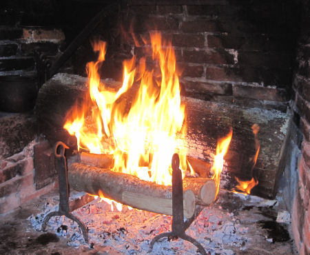 Image result for The Yule log still burning the candles turned low.