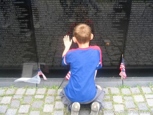 America - Child at the Viet Nam Wall in Washington