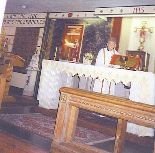 Father Kierce saying mass; date unknown but likely 1980s.