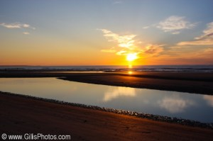 """In this obviously doctored and fake image, the supposed """"sun"""" or """"star"""" allegedly rises over Foxboro Beach.  No one in Foxboro remembers ever seeing a """"sun"""" in the sky and maintain that it has rained in Foxboro since, like, forever."""