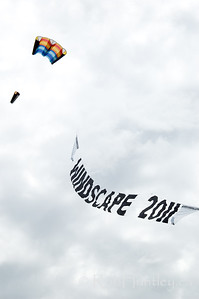 The 2011 Windscape Kite Festival banner and a rev kite