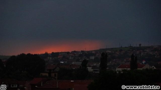 Apus ploios și ciudat în Cluj, portocaliu si plumburiu