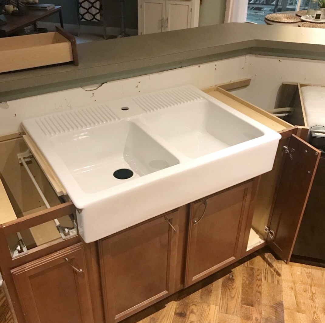 ... Panels Cut Out To Fit The Sink. They Also Had To Move The Hinges Of The  Right Cupboard And Drawer On The Left In Order To Accommodate The Length.