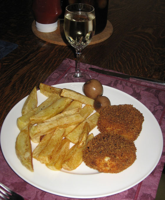 Home-made fish cakes and chips with pickled onions