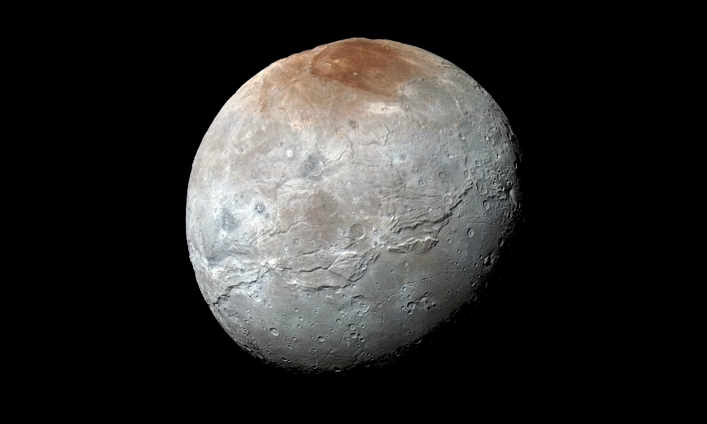 NASA's New Horizons captured this high-resolution enhanced color view of Pluto's moon Charon, showing the crack on the icy moon. It was taken just before closest approach on July 14, 2015. The image combines blue, red and infrared images and the colors are processed to best highlight the variation of surface properties across Charon.