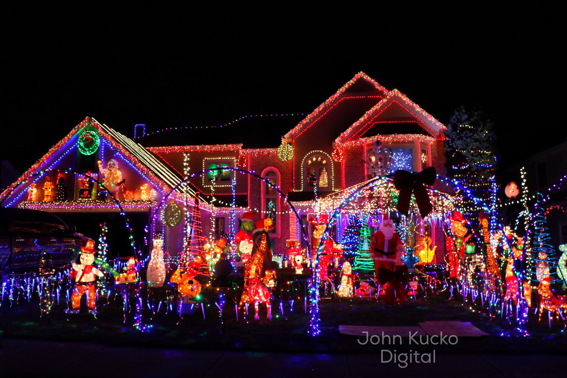 One Story House Christmas Lights.Santa Filled Yard In Irondequoit