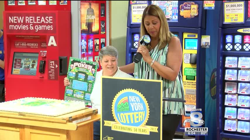 Lottery winner presented check after -1M scratch off win_87479197