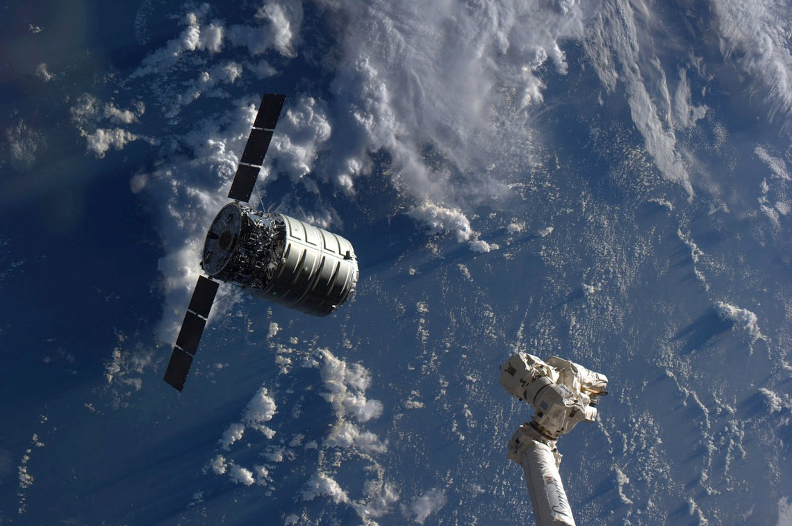 The Cygnus cargo spacecraft is just a few feet away from the International Space Station's Canadarm2. Credit: NASA