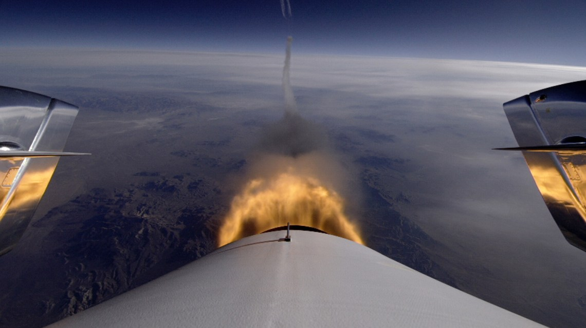 Tail-cam view of the hybrid engine burning during a test flight of SpaceShipTwo which saw the vehicle ascend to 71,000 feet over the Mojave Desert. Credit: Virgin Galactic