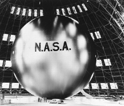 The Echo 2, a rigidized inflatable balloon, was launched into orbit by in 1964. Men and a car are seen at the base of it.  Photo: NASA