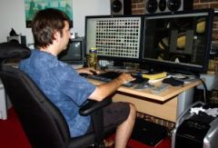 """Stephen Van Vuuren works in his basement studio on the IMAX film """"In Saturn's Rings"""" which will be released this July. Photo: SV Studios"""