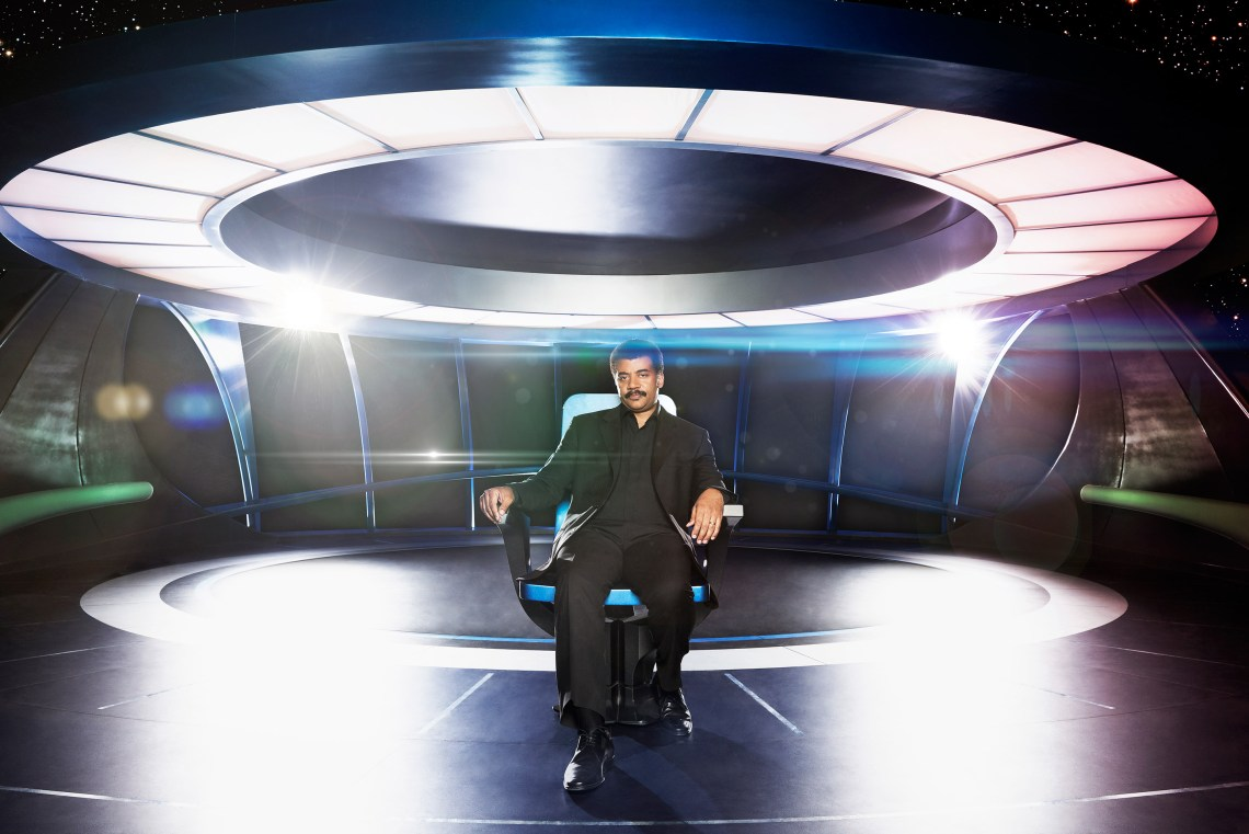 Neil deGrasse Tyson sitting aboard the bridge of The Ship of the Imagination. Image: Patrick Eccelsine/FOX