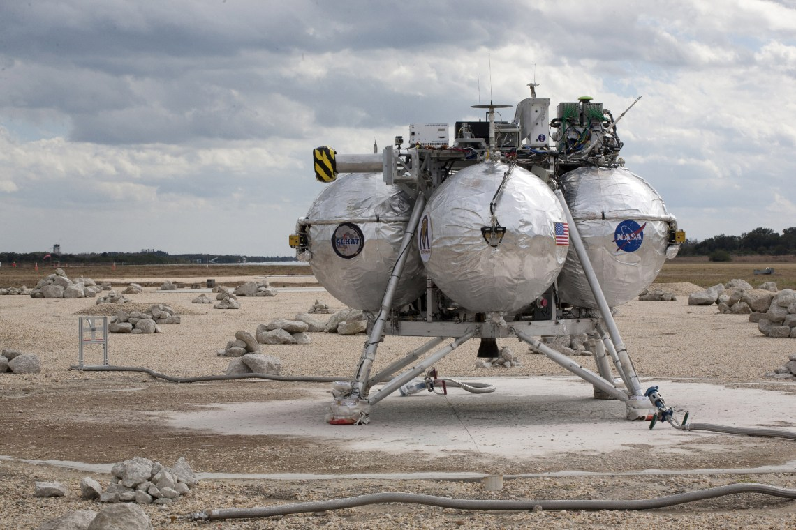 The Project Morpheus prototype lander successfully navigated the hazard field and touched down safely after launching into the sky on its fourth free-flight test. Credit: NASA/Kim Shiflett