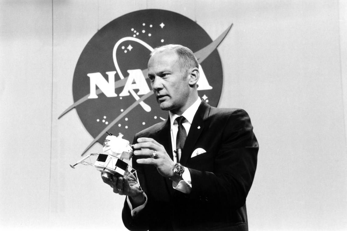 Buzz Aldrin holds up a model of the lunar lander during a press conference to announce the crew members for Apollo 11. The briefing was hel d in Houston, Texas on Jan. 10, 1969.  Credit: NASA via Retro Space Images