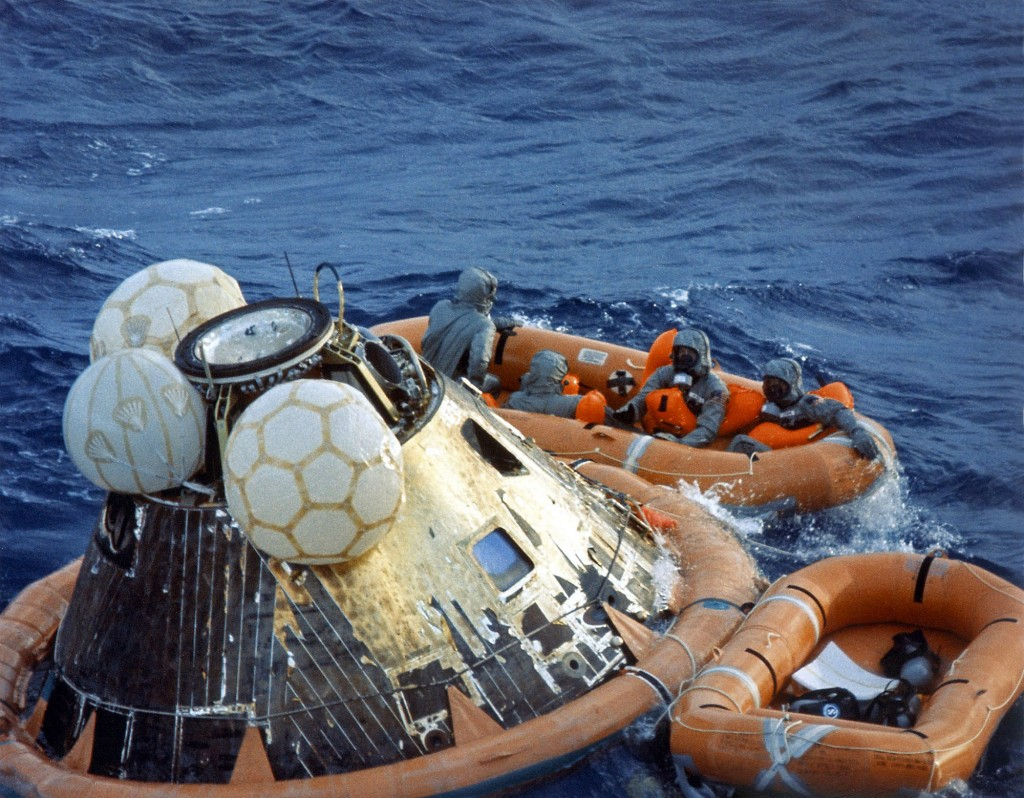 The Apollo 11 crewmen await pickup by a helicopter from the U.S.S. Hornet after splashing down at 11:40 a.m., July 24, 1969, about 812 nautical miles southwest of Hawaii.