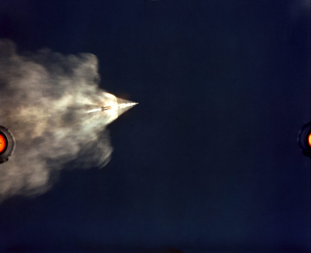 The 70mm ALOTS tracking camera mounted on an Air Force EC-135N aircraft flying at about 40,000 feet altitude photographed this event in the early moments of the Apollo 11 launch.