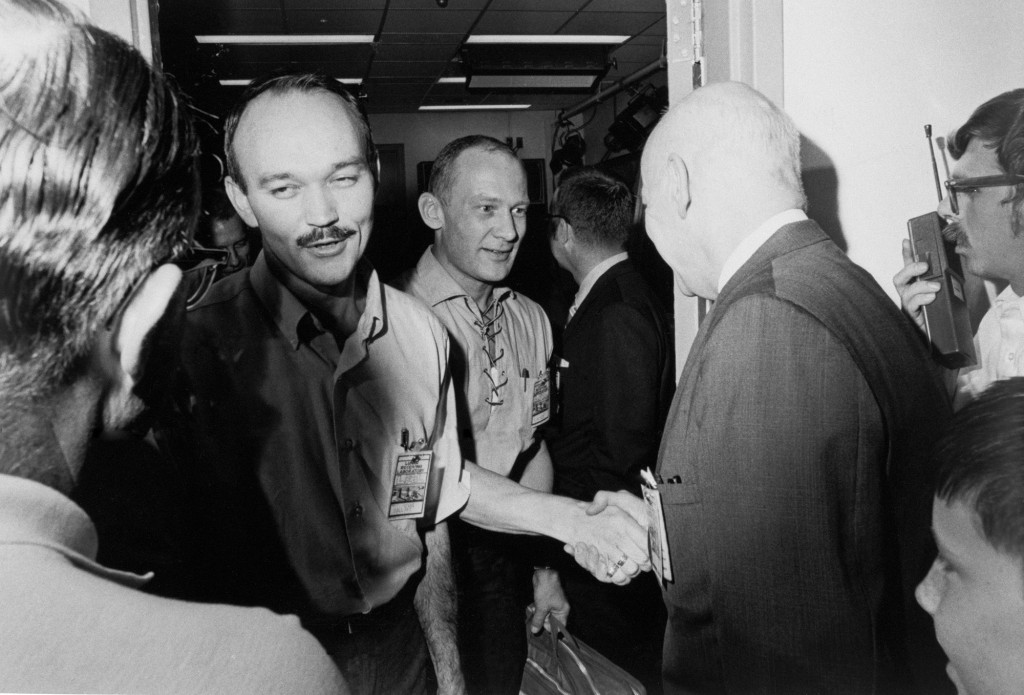 The Apollo 11 crew is greeted by Dr. Robert R. Gilruth, director of the Manned Spacecraft Center upon the astronanuts' release from quarantine on August 19, 1969.