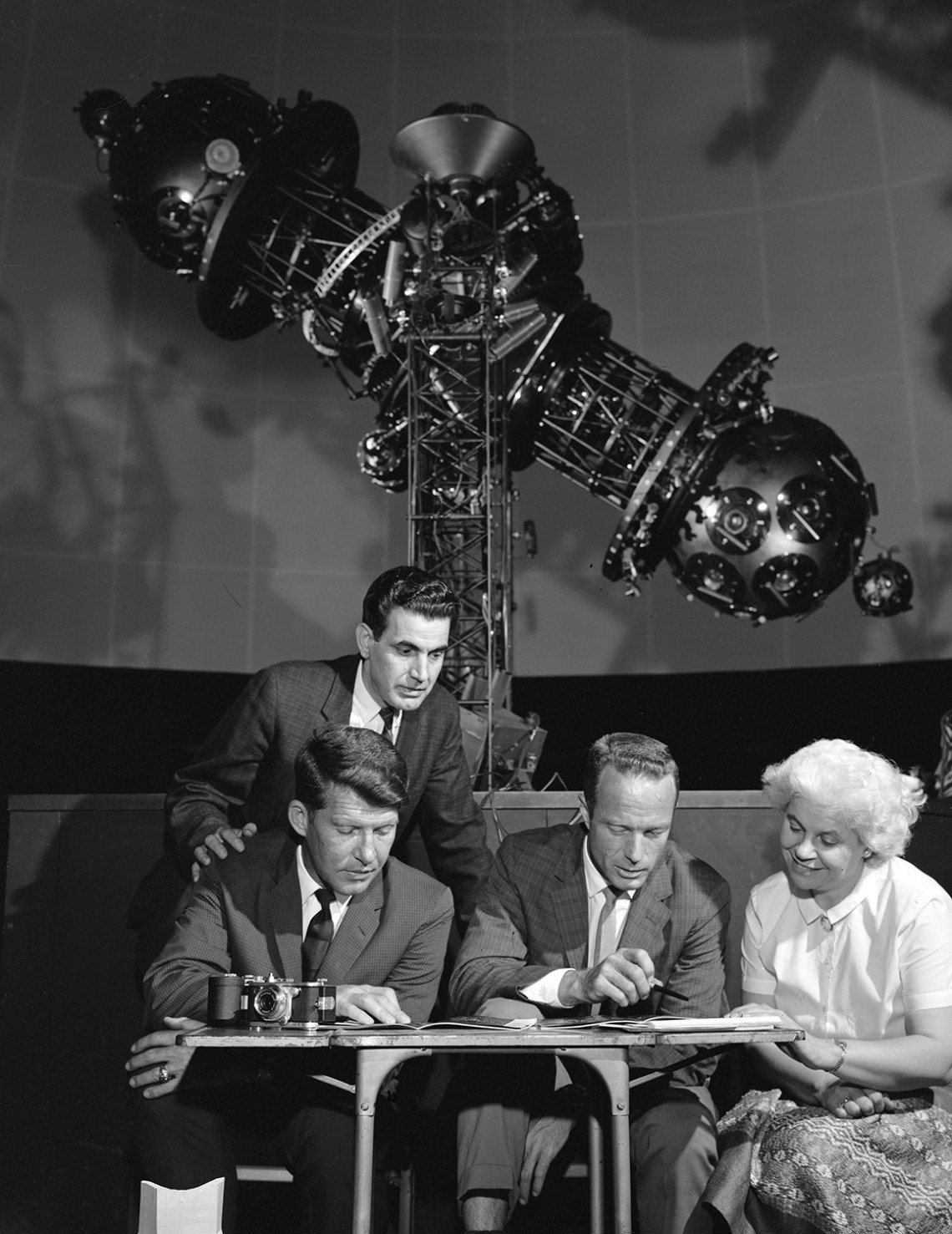 Wally Schirra and Scott Carpenter (sitting) get some help while studying star charts at Morehead Planetarium. Credit: NASA via Retro Space Images.