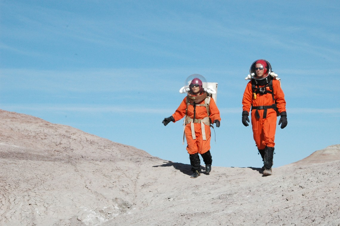 Mars Desert Research Station- exterior desert- astronauts, Kai Staats and Susan Jewell walk back to the MDRS 'Hab.' Credit: Rachael Joy/Science Channel