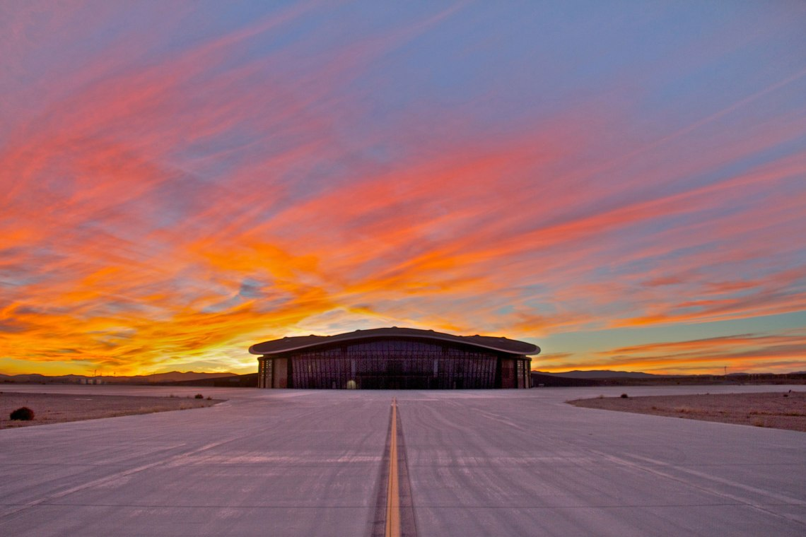 A spectacular New Mexico sunset as backdrop to the Virgin Galactic Gateway to Space terminal. Credit: Spaceport America.