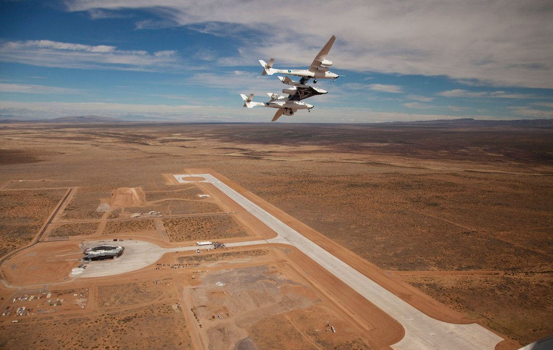 Virgin Galactic's WhiteKnight2 and SpaceShipTwo soar above the runway at the New Mexico Spaceport.  Credit: NMSA/Mark Greenberg