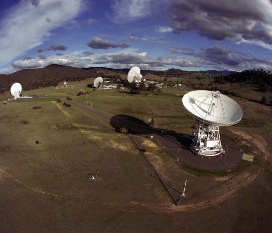 View of the Canberra Complex showing the 70m (230 ft.) antenna and the 34m (110 ft.) antennas. Credit: NASA/JPL-Caltech
