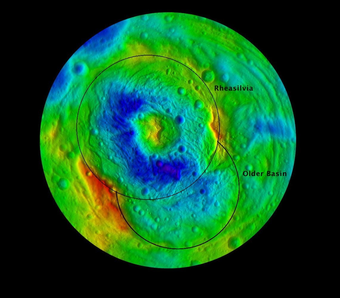 False colour image showing the relief of Vesta's south polar region and the giant Rheasilvia impact basin with its central peak. Blue areas represent lower elevation, while yellow and red areas show the highest elevations. Credit: NASA/JPL-Caltech/ UCLA/MPS/DLR/IDA