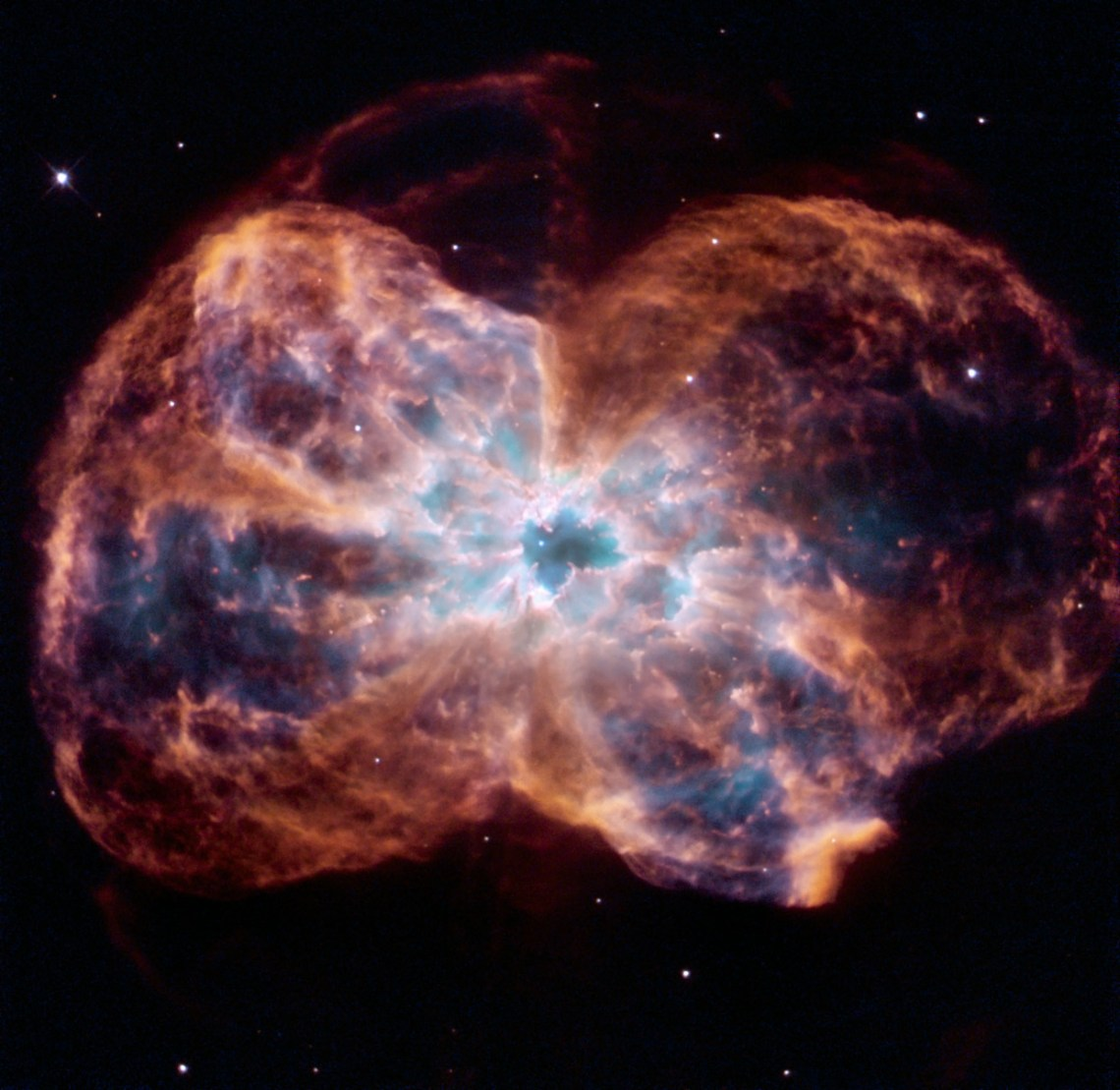 "This image of NGC 2440 shows the colourful ""last hurrah"" of a star like our Sun. The star is ending its life by casting off its outer layers of gas, which formed a cocoon around the star's remaining core. Ultraviolet light from the dying star makes the material glow. The burned-out star, called a white dwarf, is the white dot in the centre. Credit: NASA, ESA, and K. Noll (STScI)"