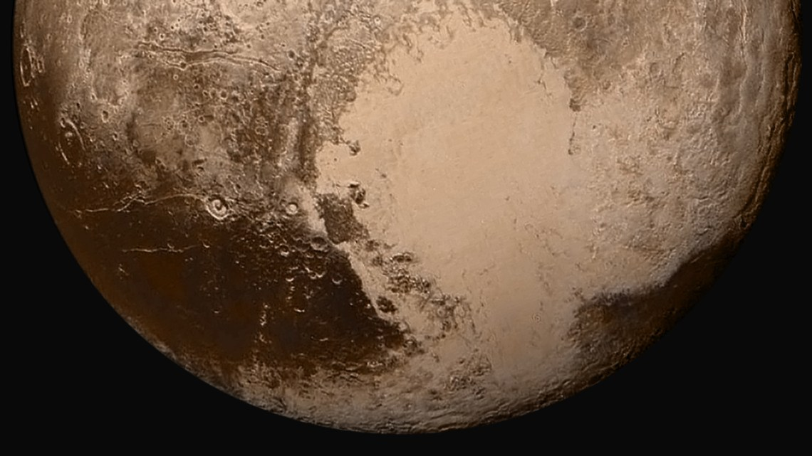 Four images from New Horizons' Long Range Reconnaissance Imager (LORRI) were combined with color data from the Ralph instrument to create this global view of Pluto. (The lower right edge of Pluto in this view currently lacks high-resolution color coverage.) The images, taken when the spacecraft was 280,000 miles (450,000 kilometers) away, show features as small as 1.4 miles (2.2 kilometers). Credit: NASA/Johns Hopkins University Applied Physics Laboratory/Southwest Research Institute