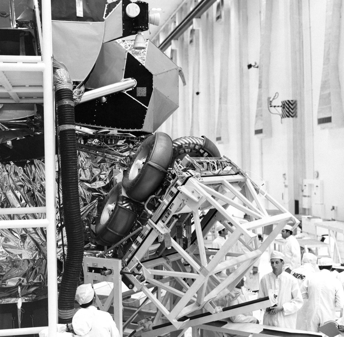 The Lunar Rover is folded up and being moved into its stored position inside the Apollo 15 Lunar Module, where it will remain until its deployment on the Moon's surface. Credit: NASA via Retro Space Images