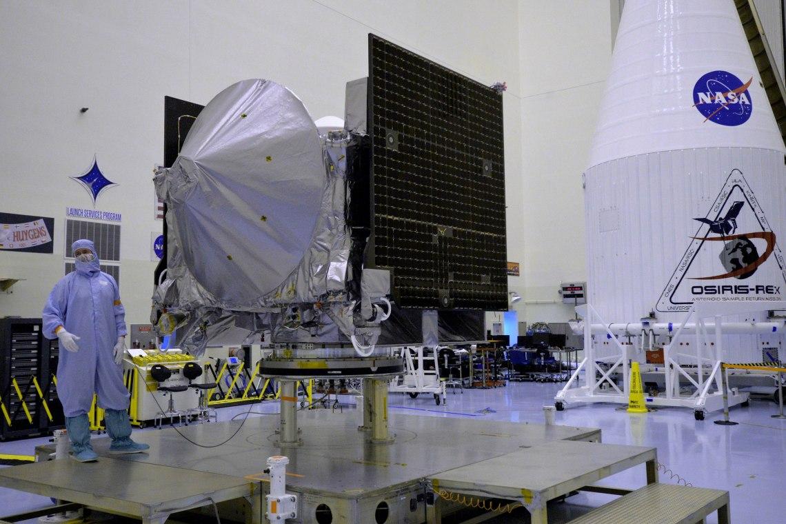 The OSIRIS-REx spacecraft resides in cleanroom as it undergoes final preparations before encapsulation for launch aboard an Atlas V rocket on Sept. 8. Credit: Julian Leek/JNN