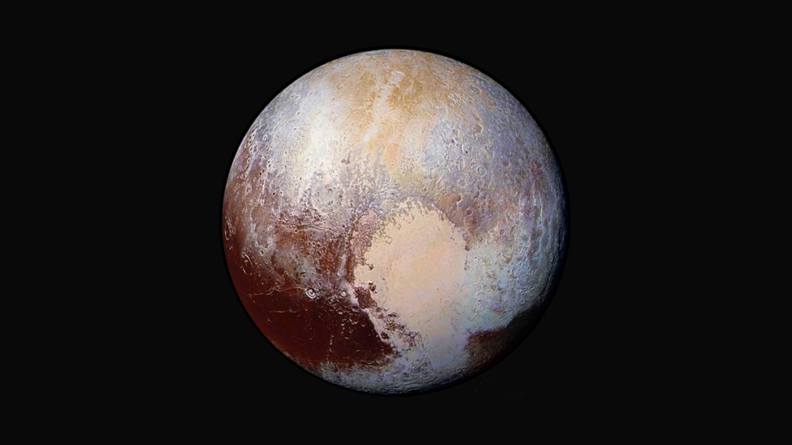 Figure 1: Iconic image – the enhanced-colour portrait of Pluto taken by New Horizons' Long Range Reconnaissance Imager (LORRI) from a distance of 450,000 km (280,000 miles). Centred on the 'heart' of Tombaugh Regio, it shows features as small as 2.2 km (1.4 miles). Four images were combined with colour data from the Ralph instrument to create this view. Credit: NASA/JHUAPL/SwRI