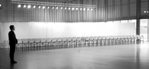 Man in an empty room with chairs