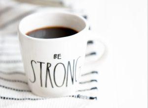white ceramic mug filled with black coffee