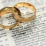 wedding rings on open Bible
