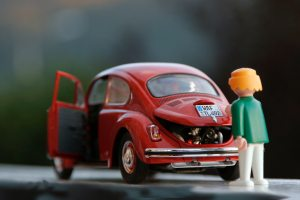 toy VW beetle and toy mechanic