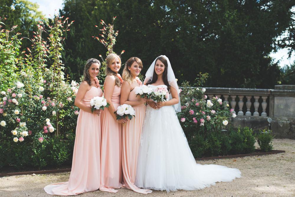 A beautiful six month pregnant bride in an Ellis bridal dress has a classic peach colour scheme