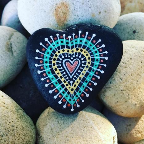 Heart shaped painted mandala rock