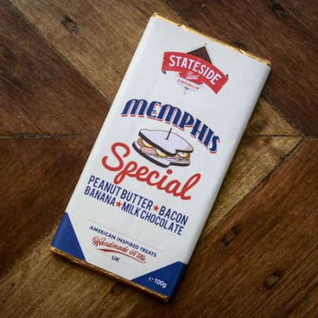 Image of a bar of Stateside Chocolate Memphis Special. Peanut Butter, bacon, banana milk chocolate.