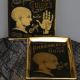 image of a black and gold trinket dish with a phrenology guide design