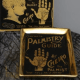 image of a black and gold trinket dish with a palmistry guide design