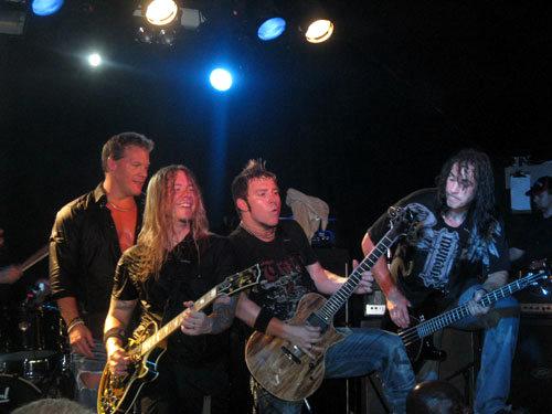 Members of fozzy guitar shredding