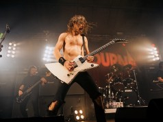 Airbourne on stage at Portsmouth Pyramids, November 2013
