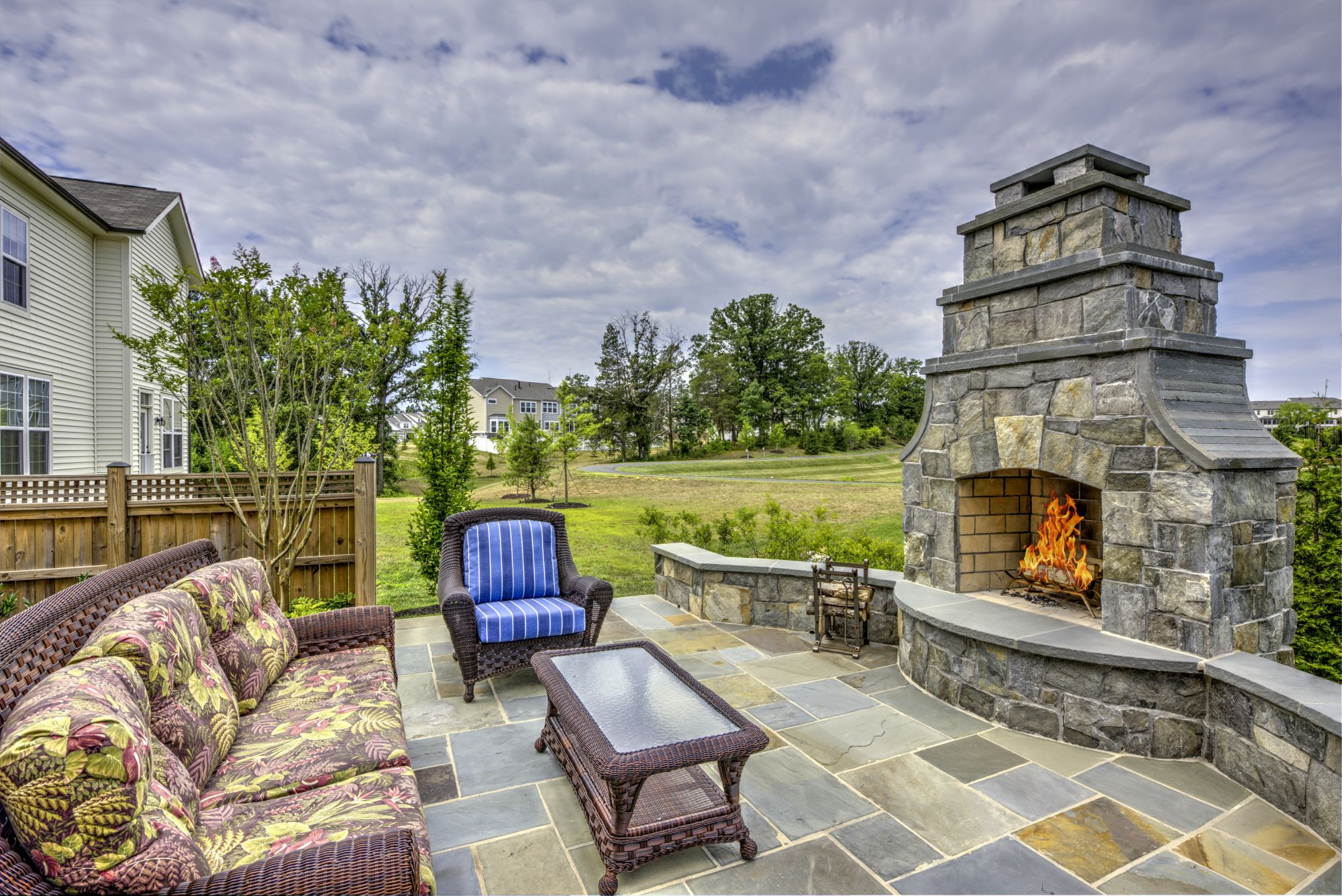 an outdoor fireplace vs fire pit