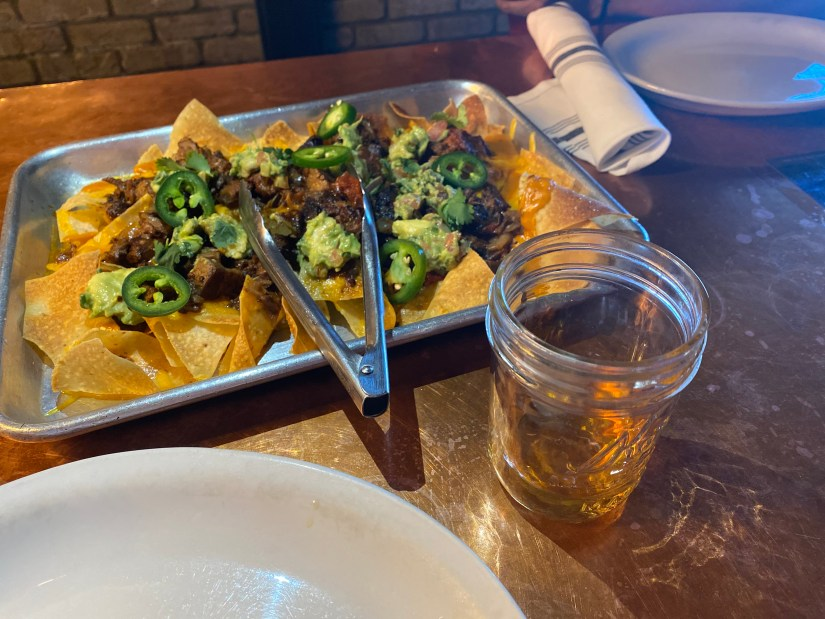 Beef Brisket Hash Nachos and Apple Pie Moonshine at Bootleggers © Rocky Mountain Food Tours