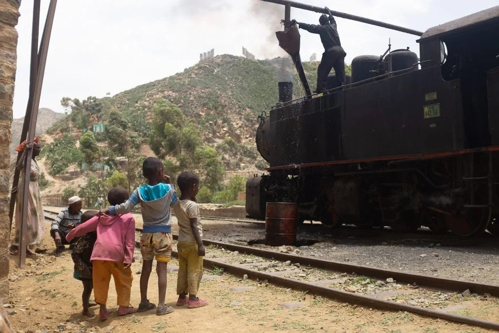 local kids beside a train in Eritrea