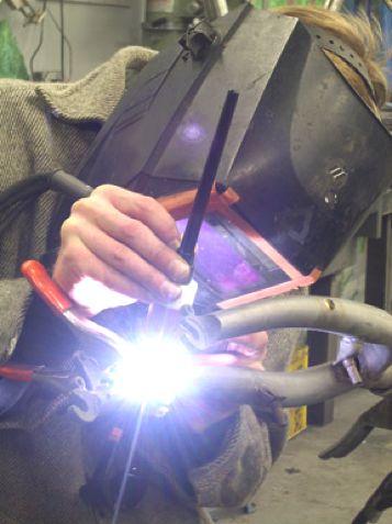 Todd welding a bike frame